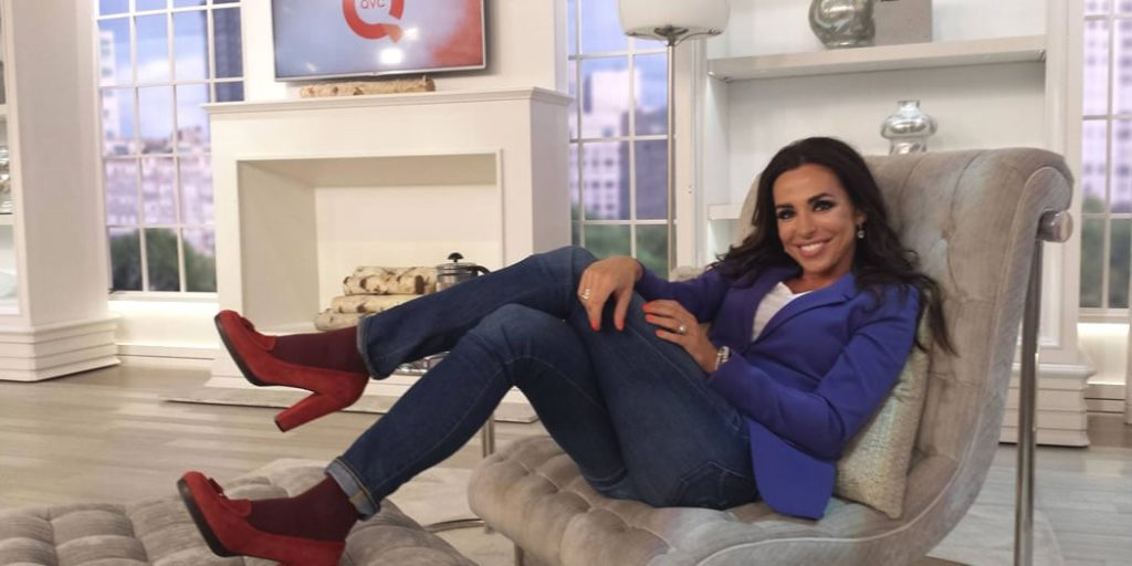 talent host sitting on a couch
